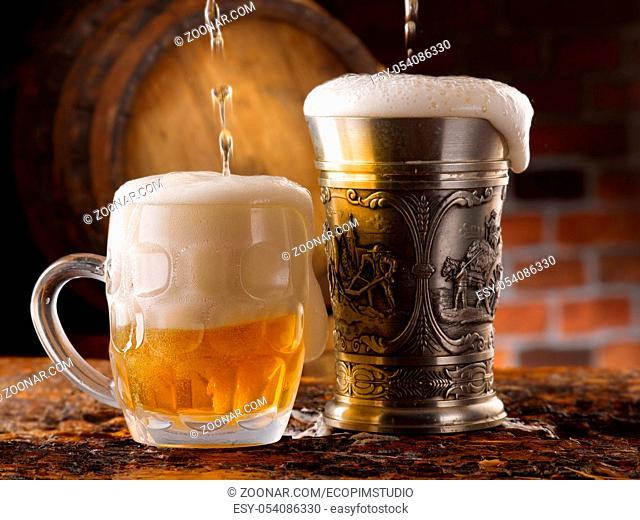 mug of beer and barrels in small cellar