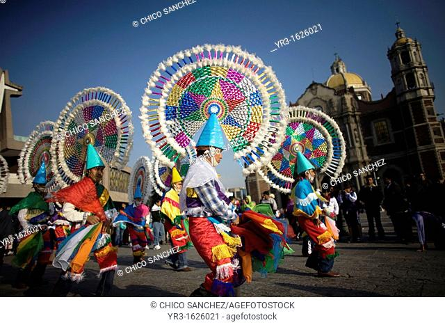 Dancers from Huehuetla, Puebla state, perform the Quetzal dance outside the Our Lady of Guadalupe Basilica in Mexico City, December 10