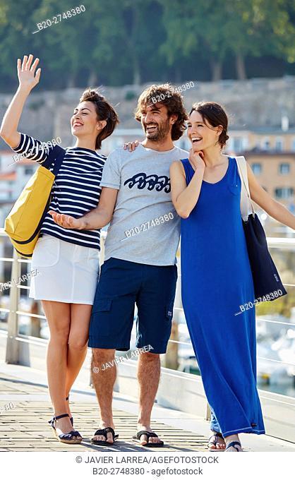 Young friends, Port, Donostia, San Sebastian, Gipuzkoa, Basque Country, Spain, Europe
