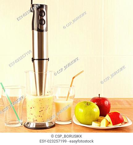 Preparing milkshake with fresh fruits in blender