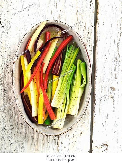 Assorted Vegetable Sticks in an Oval Dish; From Above