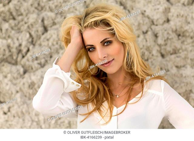 Young woman, blonde, posing in white blouse, fashion, lifestyle, portrait, photo shooting