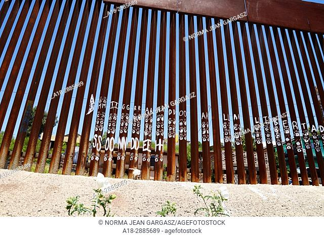 Commentary on the wall that indicates the international border with Nogales, Arizona, USA, as seen from Nogales, Sonora, Mexico