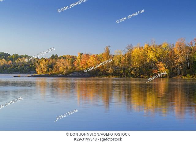 Autumn reflections in the Vermilion River, Greater Sudbury, Ontario, Canada