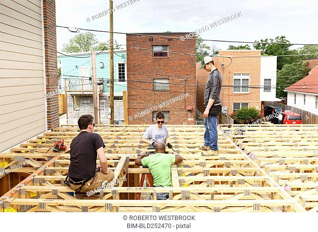 Volunteers on the roof at construction site