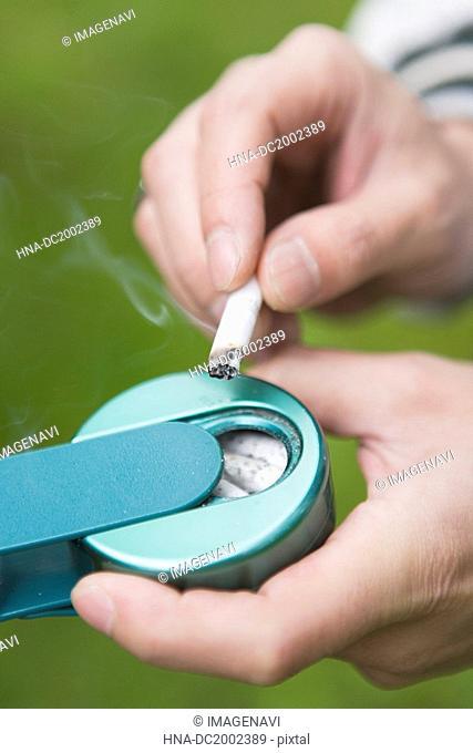 Portable Ashtray and Cigarette