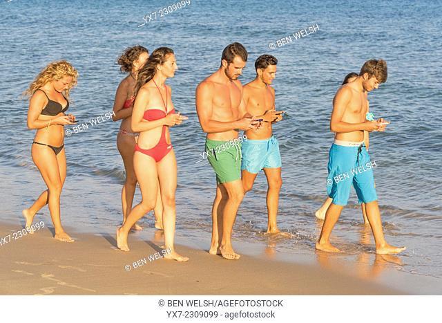 Group of friends at the beach. Punta Paloma, Tarifa, Costa de la Luz, Cadiz, Andalusia, Spain