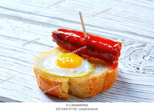 pinchos pintxos chistorra with quail egg tapas from Spain sausage food