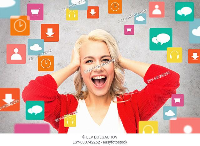 multimedia and people concept - happy young woman in red cardigan holding her head and laughing over gray background with menu icons