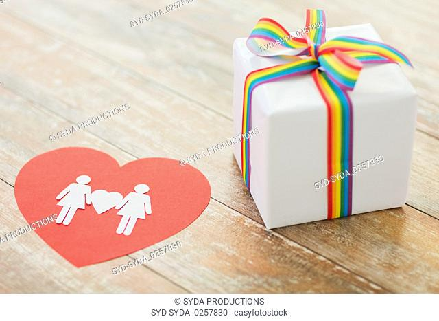 gift with gay awareness ribbon and woman pictogram