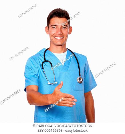 Portrait of an attractive nurse gesturing a greeting with hand on white background