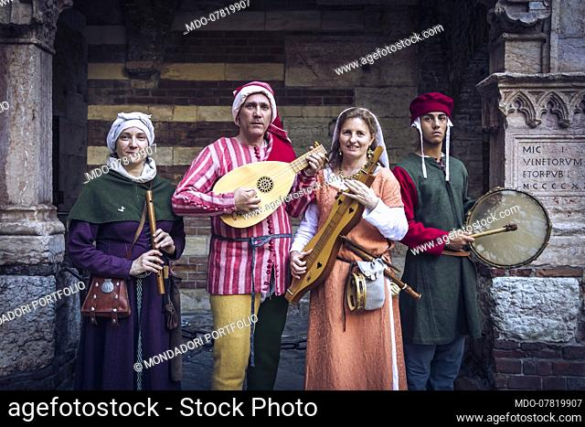 Italian Middle Ages Late 14th Century. Hypothetical reenactment of customs and traditions. Musicians with wind, string and percussion instruments