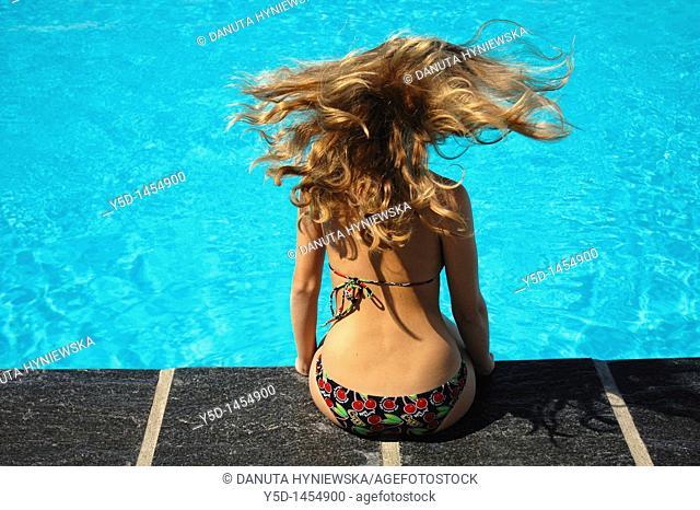 young woman enjoying summer at swimming pool, Geneva, Switzerland