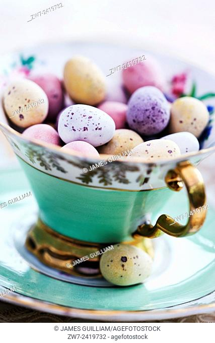 Candy coated chocolate easter eggs in antique china tea cup