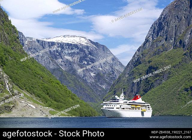 Cruise ship in the Naeroyfjorden, Aurland, Sogn og Fjordane, Norway. The Cruise ship is the Braemar, owned by Fred Olsen Cruise Lines
