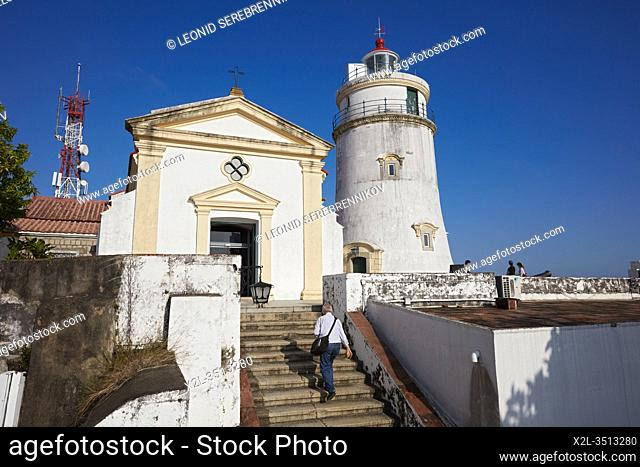 Man walking up the stair at the Guia Fortress, a 17th-century colonial military fort, chapel and lighthouse complex in Macau, China