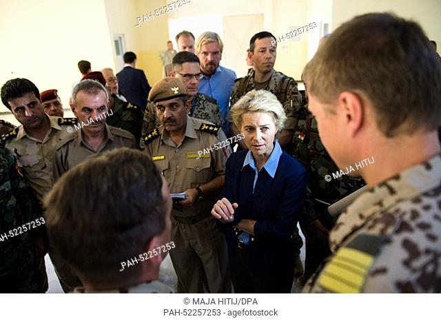 German Minister of Defence Ursula von der Leyen (CDU, 2-R) talks to soldiers of the German Armed Forces and to members of the Kurdish military in a barracks at...