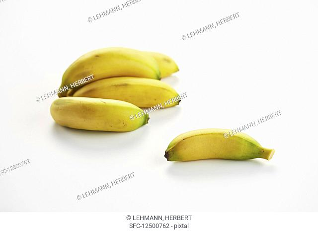 Bananas on a white surface