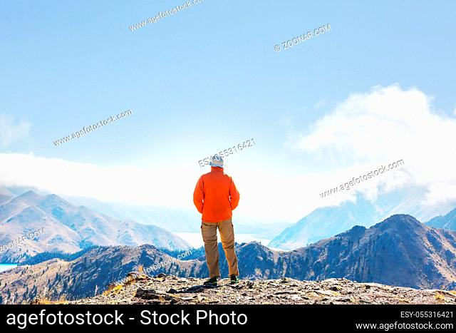 Man walking on hike trail route with Mount Cook National Park, beautiful mountains region. Tramping, hiking, travel in New Zealand