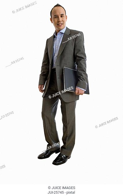 Businessman in suit carrying binder