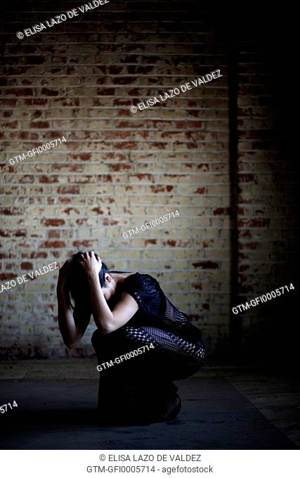 Woman in Lace Dress Crouching