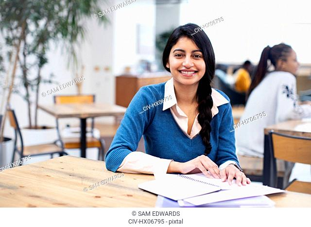 Portrait confident, smiling businesswoman working in office