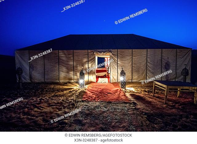 Lit Entrance to Campsite at Night, Merzouga, Morocco. Sahara Desert - Erg Chabbi dunes