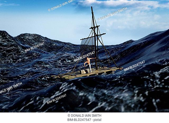 Man sailing on a raft in stormy ocean