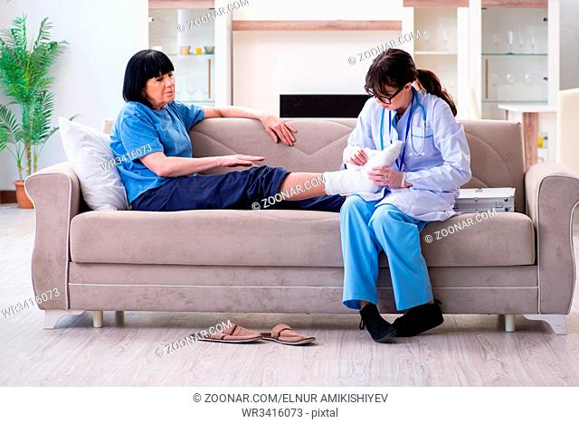 Doctor examining old mature woman after incident