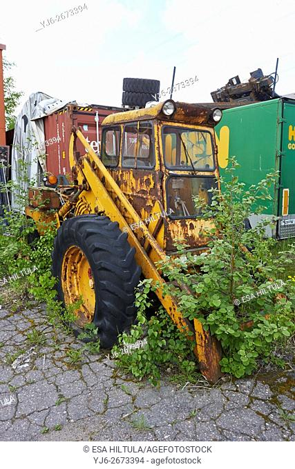 rusty old yellow tractor, Finland