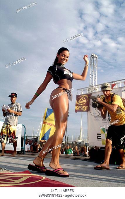 attractive female participant of beauty contest going on catwalk, Spain, Balearen, Majorca