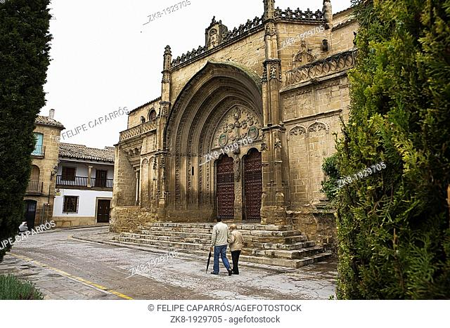 Square May 1, Fall in Chuch of Saint Paul, a couple walking near to church, Ubeda, Jaen province, Spain