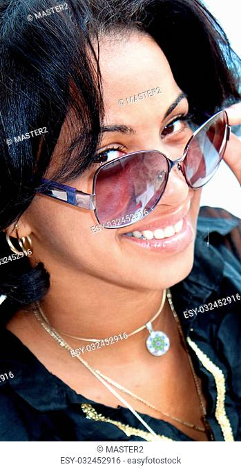 Beautiful caribbean brunette with sunglasses posing , close up
