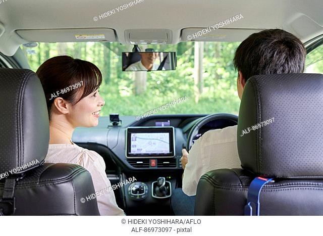 Japanese couple in the car