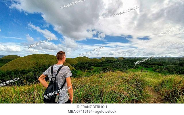 Hiker looks at the Chocolate Hills on Bohol Island, Philippines