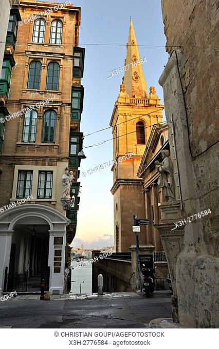 statues of saints at the corner of West and Old Theatre Streets, with St Paul's Pro-Cathedral in the background, Valletta, Malta, Southern Europe