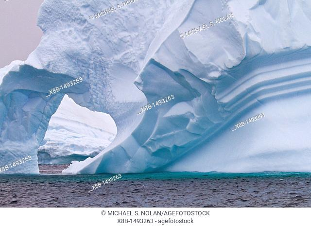 Unusual window formation in iceberg near Booth Island on the western side of the Antarctic Peninsula during the summer months