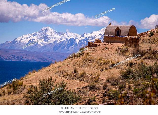 Inca ruins with Andean mountains at Island of the moon, Lake Titicaca, Bolivia
