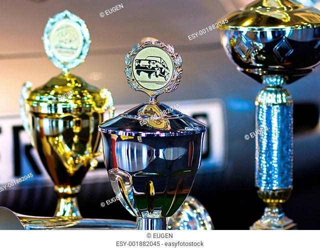 Trophy for car race winning or medal on background with a Automo
