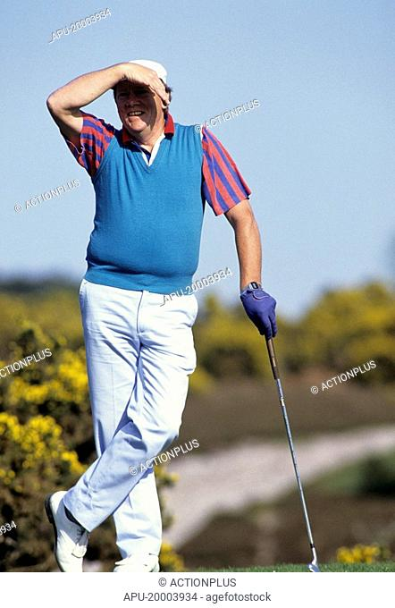 Golfer watches ball in the distance
