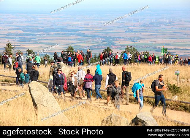 """19 September 2020, Saxony-Anhalt, Schierke: Visitors walk along the Brockenstraße. The sunny weather again attracted numerous visitors to the """"""""Brocken"""""""""""