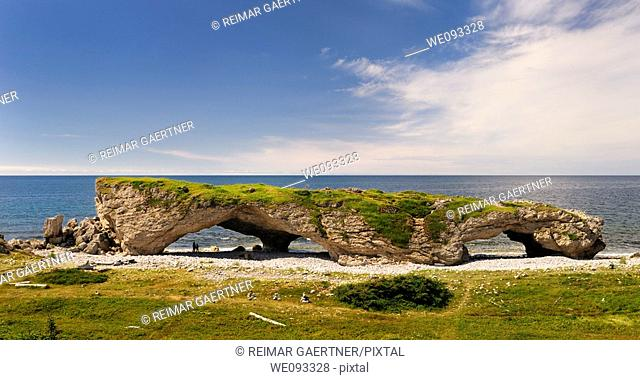 Tourists at the Arches Provincial Park Newfoundland Canada with Gulf of St  Lawrence
