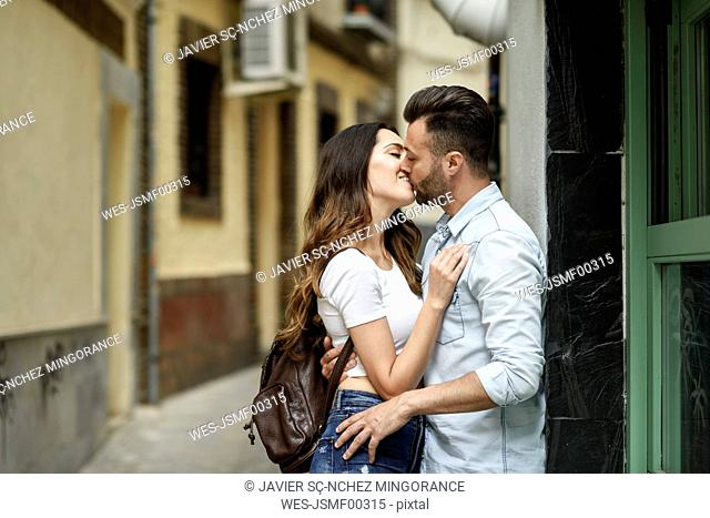 Affectionate couple in love kissing outdoors