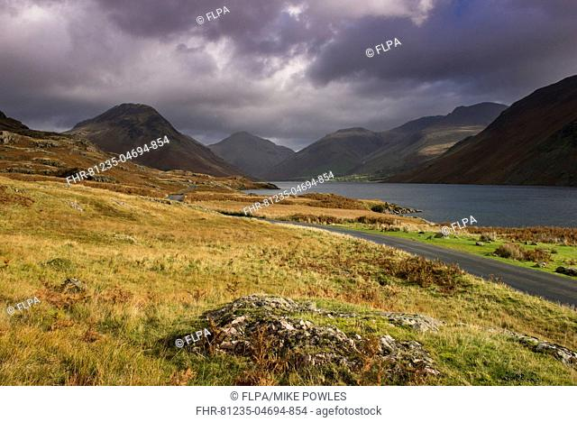 View of lake in 'over-deepened' glacial valley, deepest lake in England at 79 metres (258 feet), with Red Pike Peak and road snaking towards Wasdale Head in...