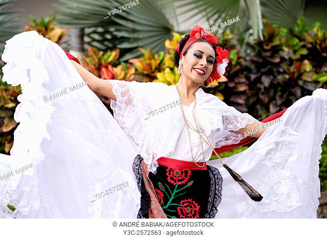 Woman dancing - Puerto Vallarta, Jalisco, Mexico. Xiutla Dancers - a folkloristic Mexican dance group in traditional costumes representing the culture and...