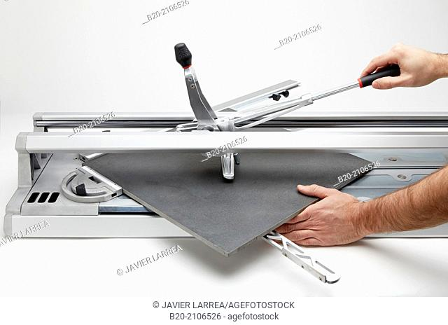 Bricklayer cutting tile. Manual tile cutter. Construction Industry