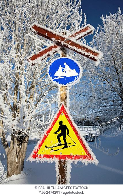 frosty traffic signs on snowmobile tracks, Finland