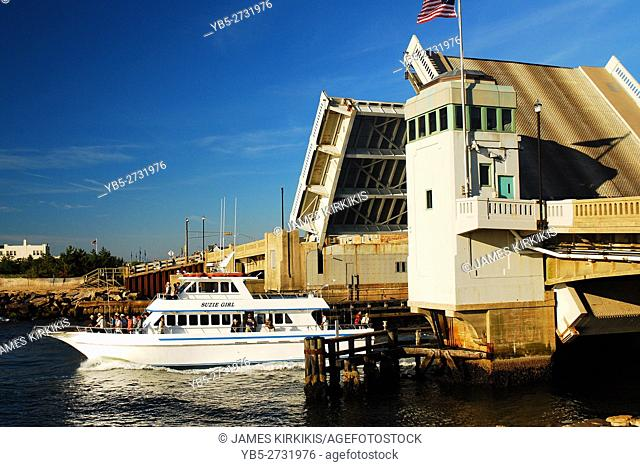 A Charter Fishing Boat Cruises under the Shark River Bridge in Belmar on the New Jersey Shore