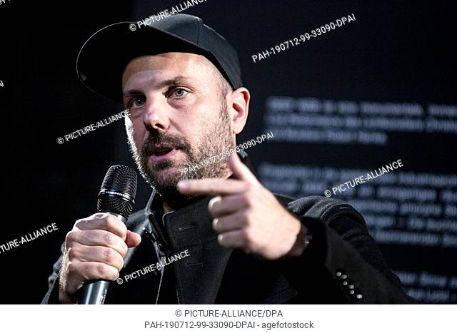 "12 July 2019, Berlin: Christopher Bauder, light artist, speaks at a press conference at the opening of his audiovisual installation and live performance """"DEEP..."