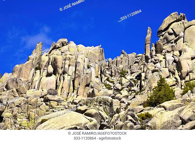 U Col and Cigar cliff in The Pedriza Regional Park Cuenca Alta del Manzanares Madrid Spain